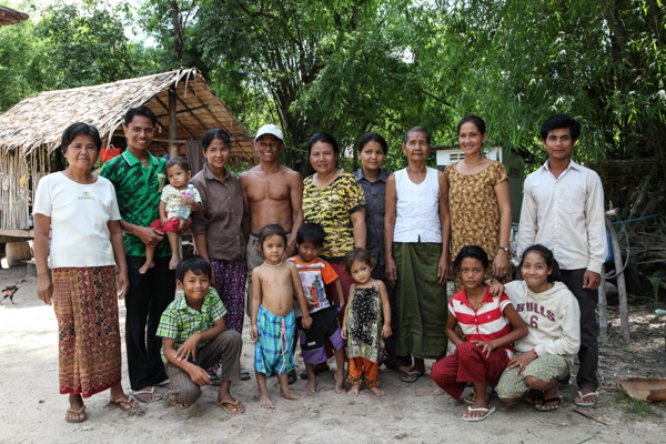 Marin (pictured second from left in the green shirt) with his family, some close village friends and students.